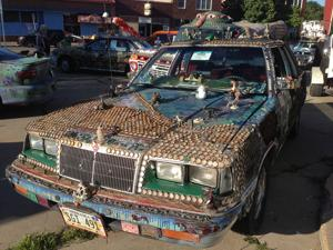 The story behind that car covered in bottle caps and dinosaurs
