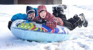 Omaha snowfall makes kids happy, drivers really happy