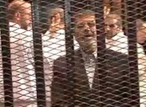Egypt's Morsi defiant as his trial begins
