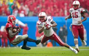 Notes: Reeves leaves field on stretcher; Pelini says it's precautionary