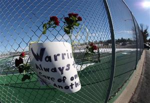 Colorado governor visits school shooting victim