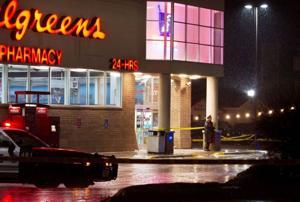 Man shot by police during drug ring bust; meth, cash, guns seized