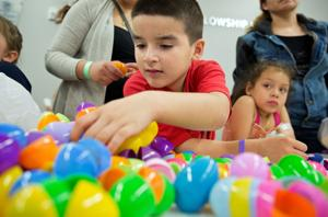 Kroc Center egg hunt adds splash of color to overcast Sunday