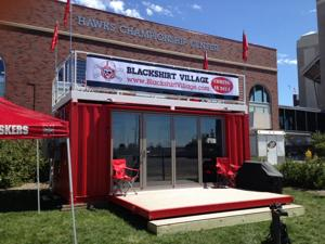 Steel shipping container turned into luxury tailgating party for Husker football fans