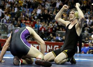 Huskers' Kokesh and Green finish as All-Americans; Iowa's St. John takes title
