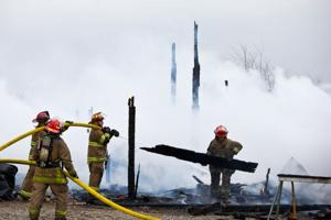 Firefighters take on 'fully engulfed barn fire'