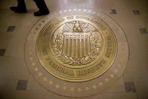 Improving U.S. economy leads Fed to ease stimulus