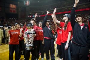 NU women given big reception in return home with title