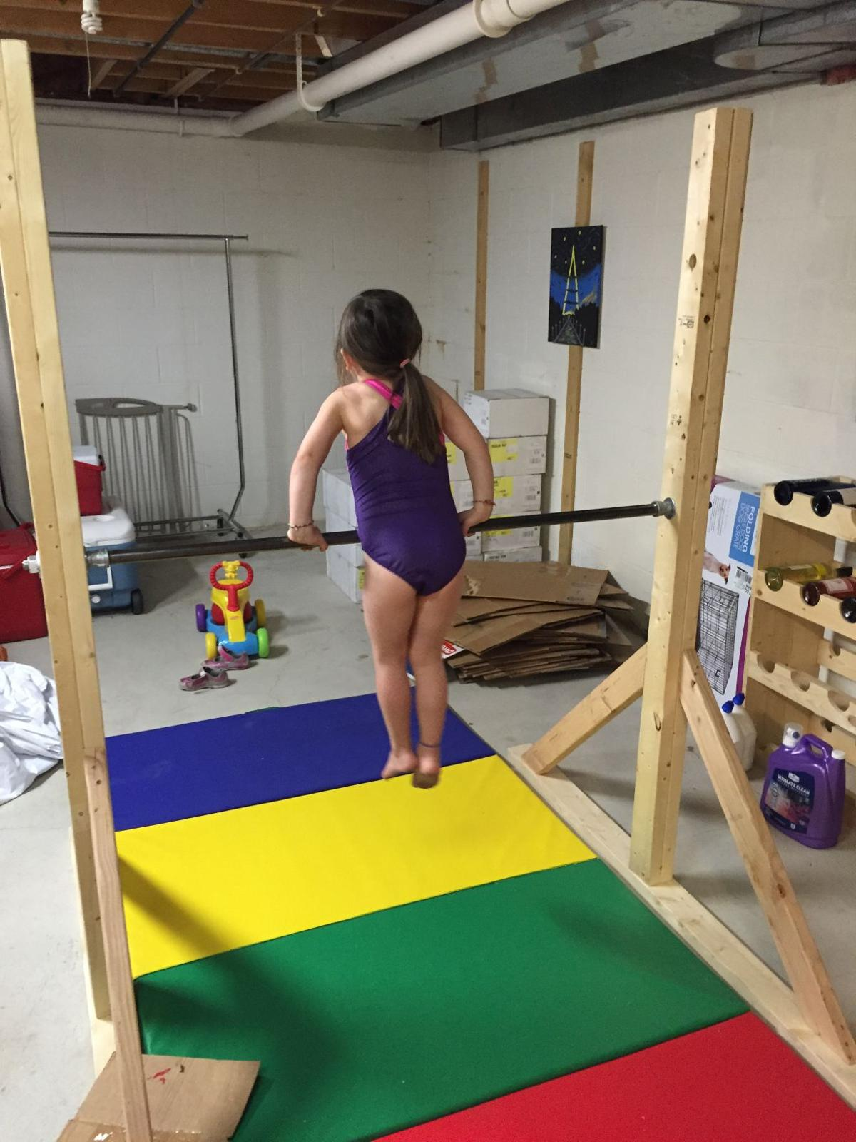 Dad tackles home gymnastics project gets unexpected for How to build your own bar cheap