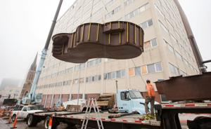 You don't see this every day: Workers hoist pool to downtown apartment's top floor