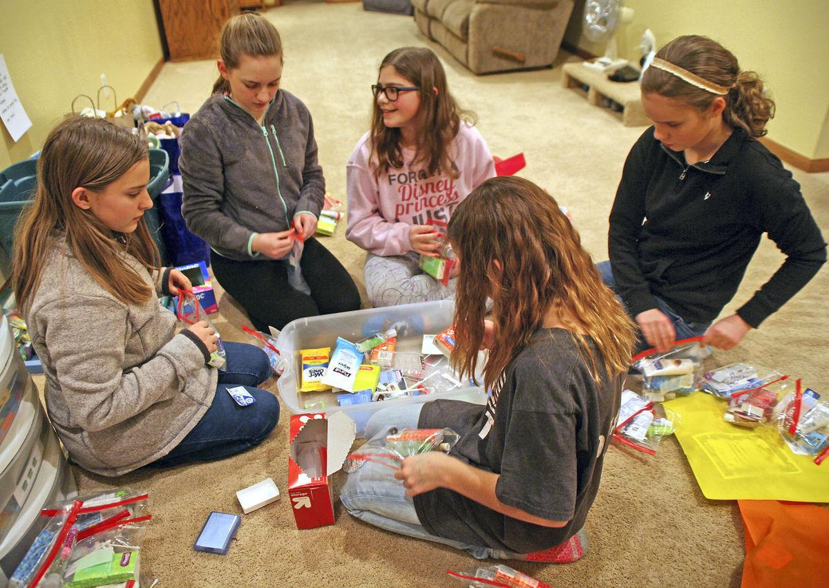 girl scouts make brave bags to  fort local children