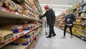 Stores busy as shoppers stock up on staples before storm