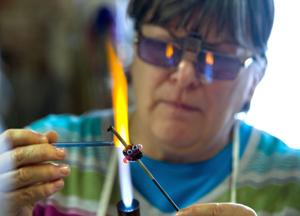 Program helps kids describe their health struggles, one glass bead at a time