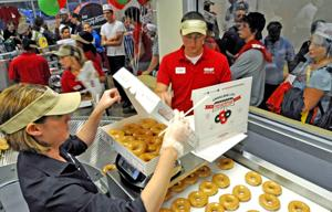 Win free doughnuts for a year at new Bluffs' Krispy Kreme by ...