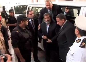 Ousted Egypt president's family sees him in prison