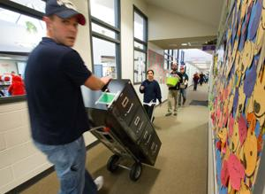 'Dad Army' deploys at Millard's Upchurch Elementary to help move furniture into new classrooms