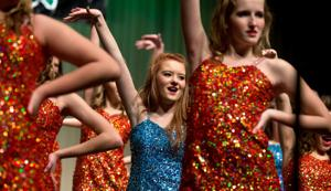Show choirs take center stage at 8th annual Singsation competition