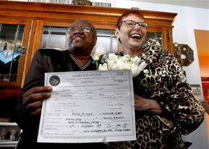 Same-sex couple's wedding a first for Illinois