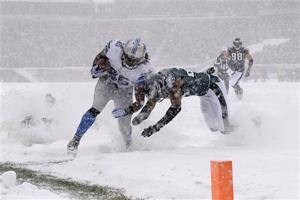 Old Man Winter frosts NFL gridirons with snow, ice