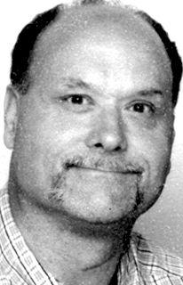 Earl Schmitt, 57, known for hard work, stock car racing