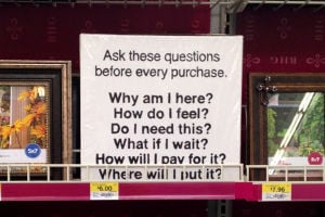 At Walmart and Target, his signs ask shoppers to pause before purchase