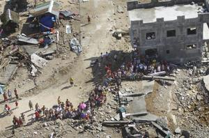 Typhoon-struck Philippine city begins mass burial