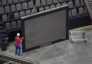 Crews begin CenturyLink scoreboard swap