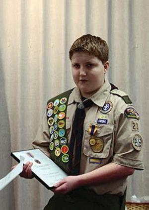 Bluffs Scout gets national heroism award for attempt to save dying dad