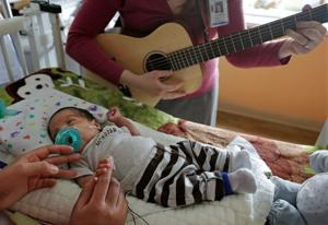 Live music soothes smallest patients