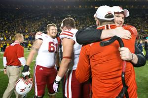 Battered Husker offensive line credits coach Garrison with keeping faith