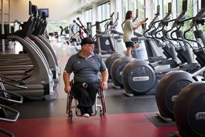 Grace: Wheelchair athlete doesn't dwell on closed doors; he's pushed open many others