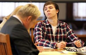 Convict testifies that Iowa teen charged in grandparents' deaths sought killing tips