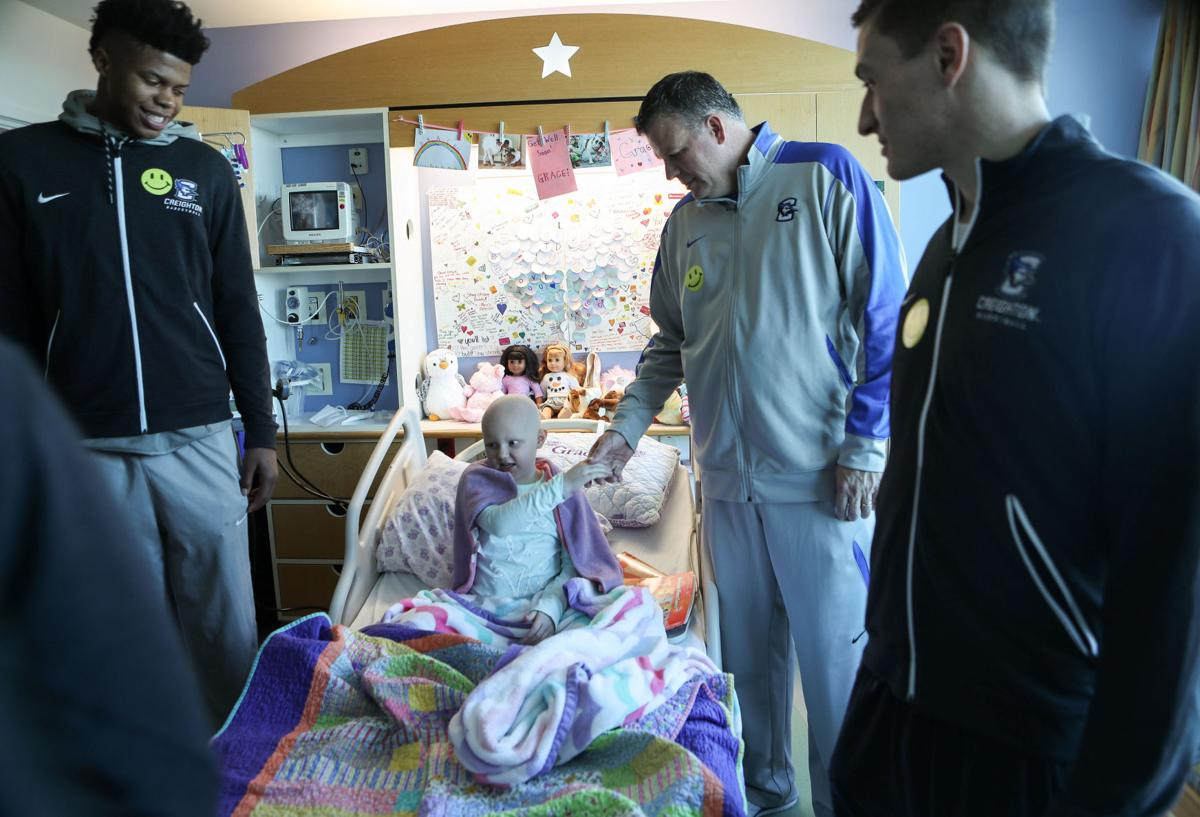 Creighton basketball players score smiles in visit to ...