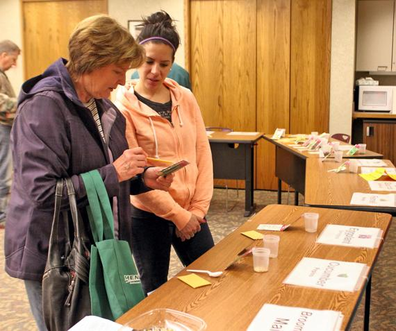 <p>Photo by Katherine Leszczynski Nancy Evon and her daughter Alicia check out the seeds available at the Baright Public Library Seed Share on Saturday. This was the first year that Baright hosted a Seed Share.</p>