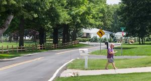 Country club neighborhood now sees Senior Open golf tourney as a blessing, not a bother