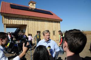 Investor Tom Steyer helps dedicate 'clean energy' barn in pipeline's path