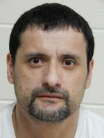 La Vista man charged in '03 Bluffs slaying waives speedy trial, released