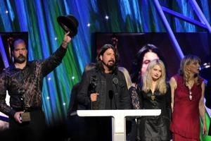 Dave Grohl and Courtney Love share stage (and hugs) at Rock and Roll Hall of Fame ceremony