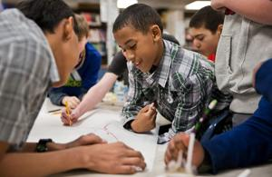 To encourage boys' reading, look to book clubs