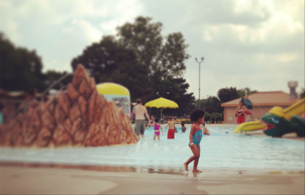 Omaha area pools splash pads open for summer for Opening pool for summer