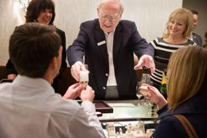 From behind Borsheims counter, Warren Buffett helps young man with marriage proposal