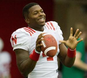Experience teaches QB Armstrong to lead Huskers in new ways
