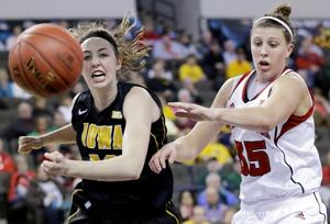 Hooper helps Huskers turn back Iowa