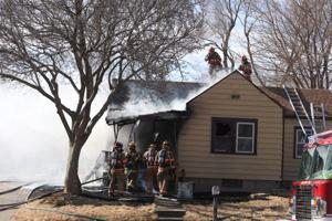 Firefighters battle 2 house fires