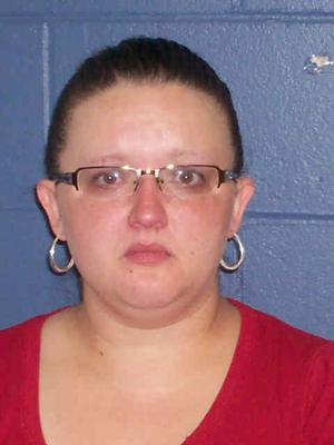 Iowa county auditor pleads not guilty to charges in meth case