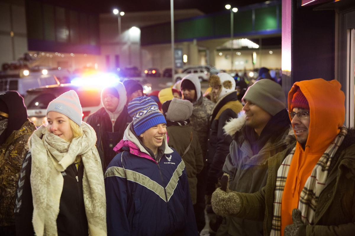 Black Friday Shoppers Brave Cold Icy Weather For Big