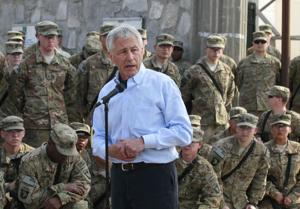 Hagel's Afghan 'transition' visit rocked by suicide bomb attacks