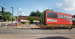 Billboard removed from damaged thrift shop