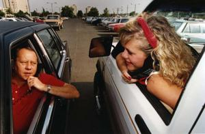 Pictures of people interacting with technology in the '90s
