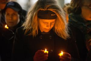 Omahans hold vigil for domestic violence victims hours after Bluffs woman killed
